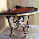 Стол блэк-джек для казино; рабочий верх – столешница – проект В. Шершакова,  Нижняя часть стола с литым декором – проект М.Р. Тренихина. Начало 1990-х.
